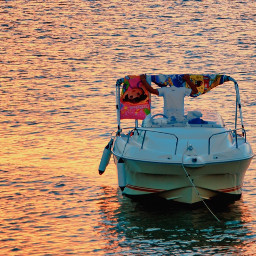 boat sunset colors man towls