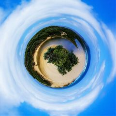 tinyplanet beach blue clouds trees